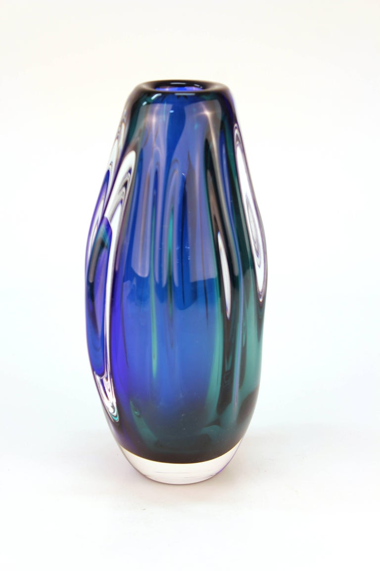 Mid-Century Modern Murano glass vase made with Sommerso technique, in cobalt blue and green or teal, encased in colorless glass. In great vintage condition with minor scratches to bottom.