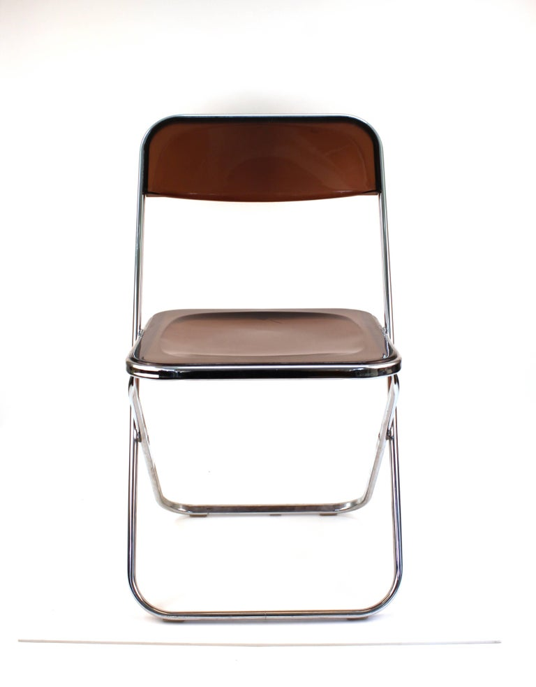 Giancarlo Piretti 'Plia' style folding chairs set of four, in smoked Lucite. The set was made in Italy in the 1970s and is in good vintage condition with age appropriate wear to the Lucite.