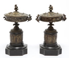 Neoclassical Bronze Tazza Urns With Lids on Black marble Plinths