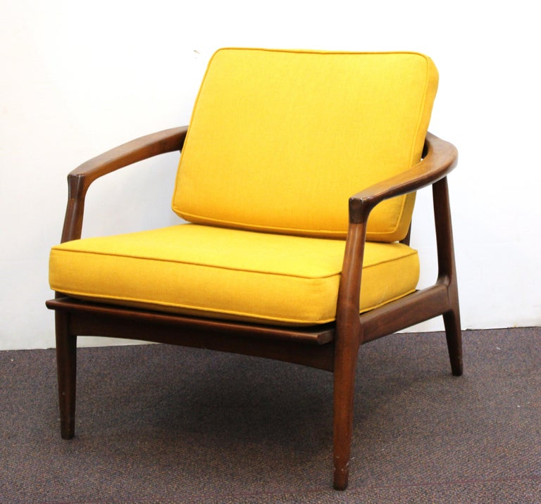Pair of Mid-Century Modern lounge chairs designed by Milo Baughman for Thayer Coggin in the mid-20th century. The pair is made in wood and has upholstered seat and back cushion. Milo Baughman for Thayer Coggin label on the seat underneath cushion.