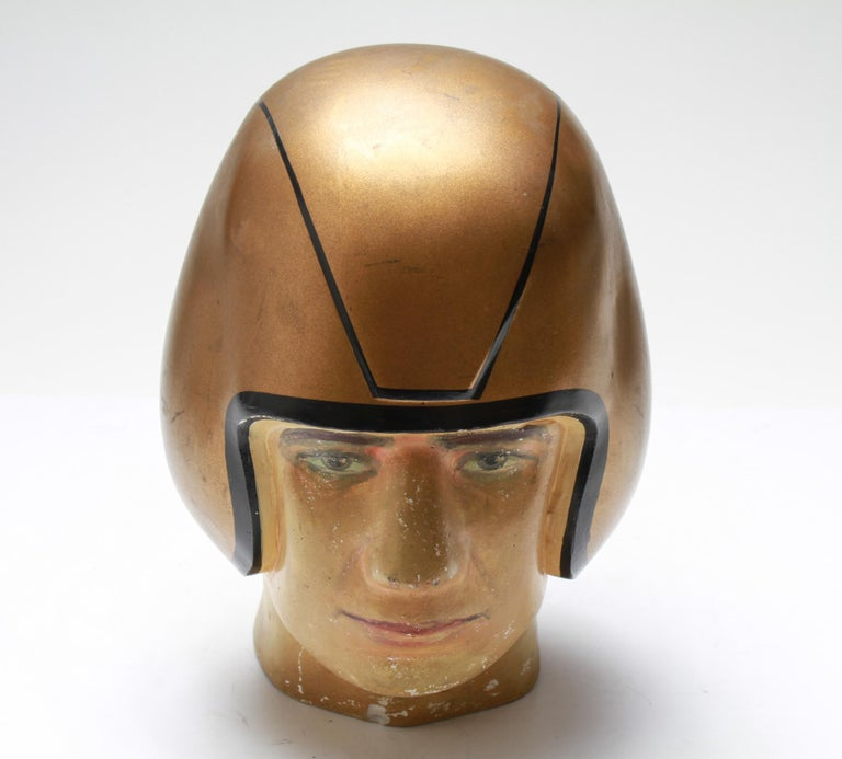 American Folk Art football player bust in composite material, wearing a gold-tone helmet. The piece is in good vintage condition and was made in the mid-20th century.