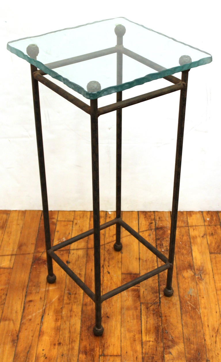 Modern set of three side tables or pedestals with a Minimalist structural metal frame with square glass tops with frosted rough-cut edges. In good vintage condition with some age-appropriate tarnish to the metal. Available individually at $400 per