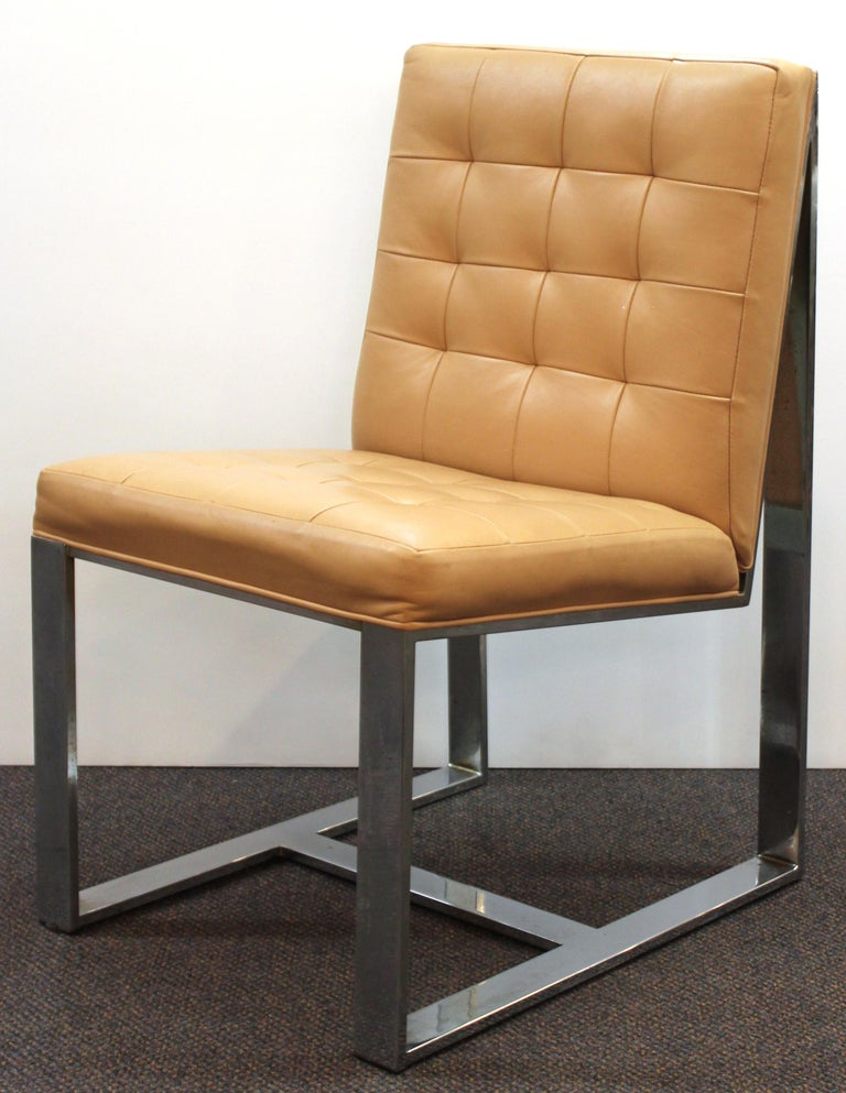 American Mid-Century Modern set of six cantilevered dining chairs with chromed flat bar structure and leather upholstery, designed by Milo Baughman in the 1970s. Some age-related tarnish and spotting to the chromed surfaces and some age-related wear