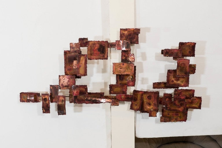 A midcentury abstract 'Brutalist' wall sculpture, in the style of Curtis Jere, composed of various sized copper rectangles. Good condition consistent with age, some patina to the copper; one side requires minor soldering.