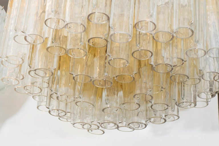 An Italian vintage, large scale Murano glass chandelier, produced circa 1960's by Venini, decorated with glass tubes, in golden yellow to clear ombre. Markings include stamp, [Venini/Murano/Made in Italy] affixed to the top of the frame. Requires
