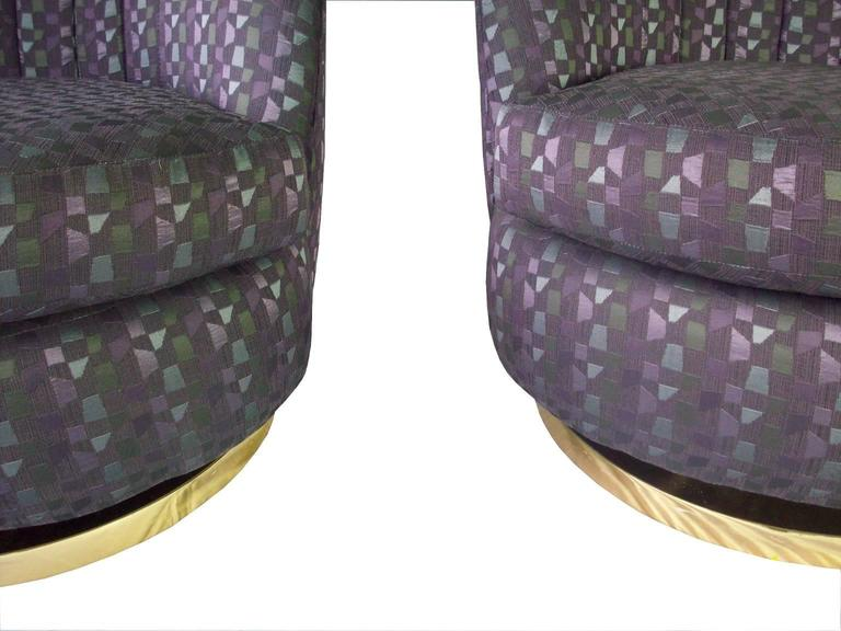 A pair of vintage scallop back lounge chairs, produced, circa 1970s by Milo Baughman, upholstered in purple patterned.  9304