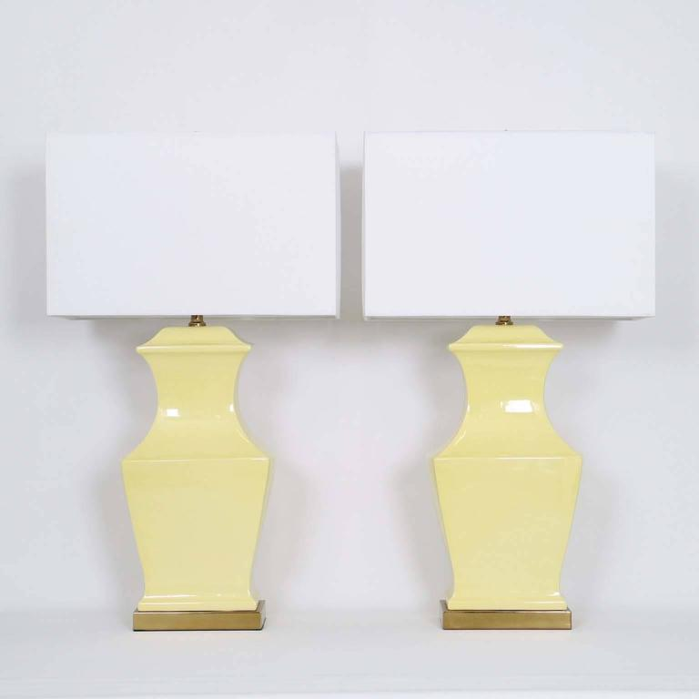 Pair of ceramic squared baluster lamps by Paul Hanson, mounted on brass bases. The noted height is to the finial; the height of the ceramic body is 17 in (43 cm). Very good vintage condition, wear is consistent with age and use. Newly