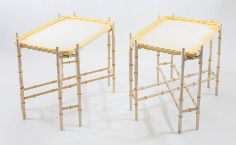 Yellow trimmed removable trays with faux bamboo bases in solid white with yellow trimmed knotches. Although tray tables, they are very sturdy. The base does not fold up which makes the surface quite solid.