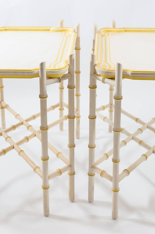 Pair of Baker Mid-Century Chinoiserie Yellow Trimmed Faux Bamboo Tray Tables In Good Condition For Sale In Asheville, NC