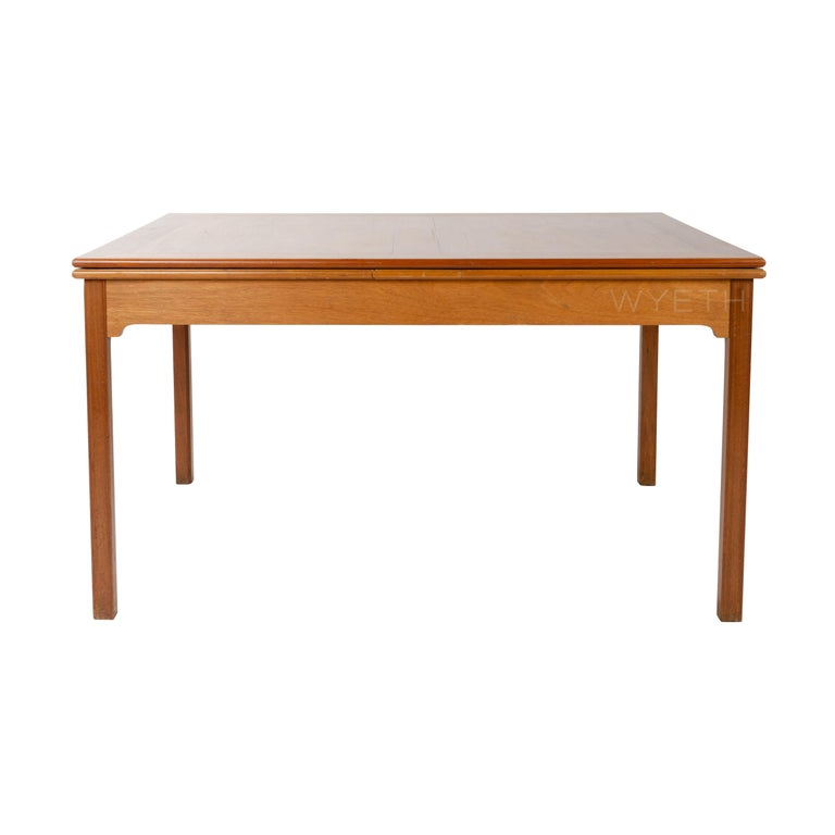 A model 4229 dining table in mahogany with two extension leaves.