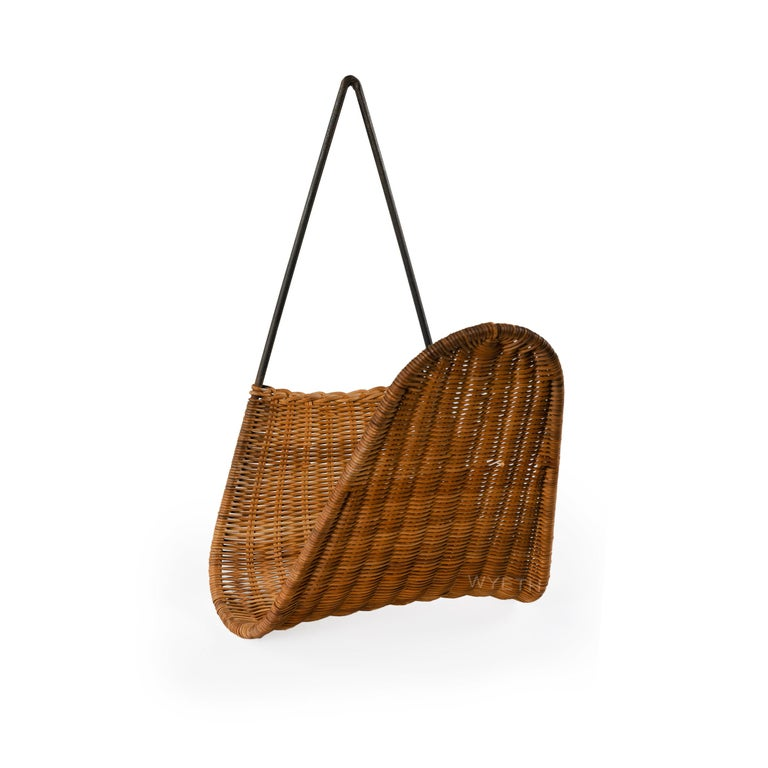 Hanging woven raffia and brass magazine rack or basket.