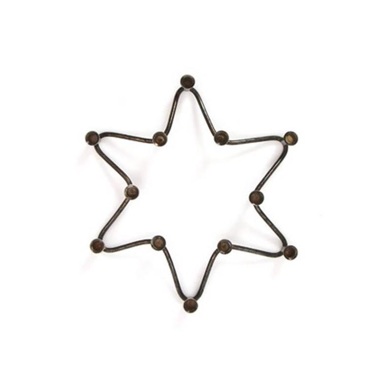 A Danish taper candleholder in the shape of a star.