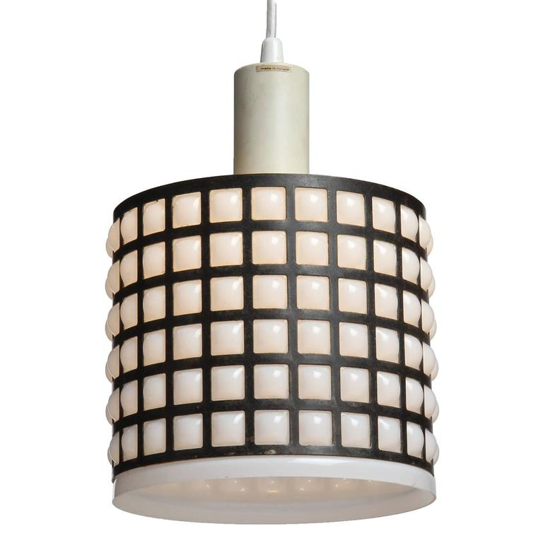 A graphic and unusual cylindrical ceiling fixture having a white glass shade blown into a patinated bronze grid.