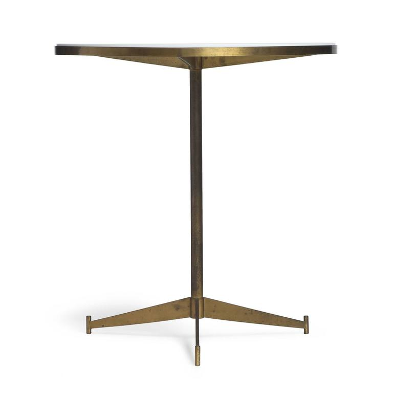 A fine brass side table having an inset opaque white glass top, pedestal with tripod base.