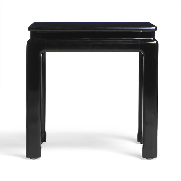 Elegant and finely proportioned pair of black lacquered mahogany end tables of Chinese inspiration.