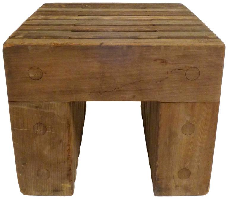 A wonderfully Minimalist and utilitarian pair of solid cedar side tables. Beautifully and practically executed with stack-lamination and doweled construction, this simple and sturdy design could also work well as a stool. These tables appear to have