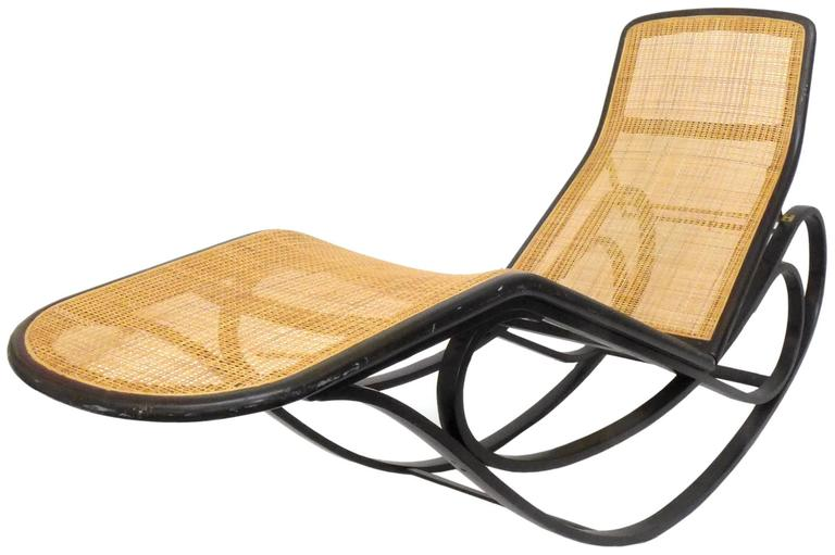 A beautiful and rare rocking chaise lounge by Edward Wormley for Dunbar. A highly-desirable icon of Mid-Century American furniture, a Thonet-inspired piece in bent ash, woven cane, and brass. Back-height is adjustable to three positions. In great,
