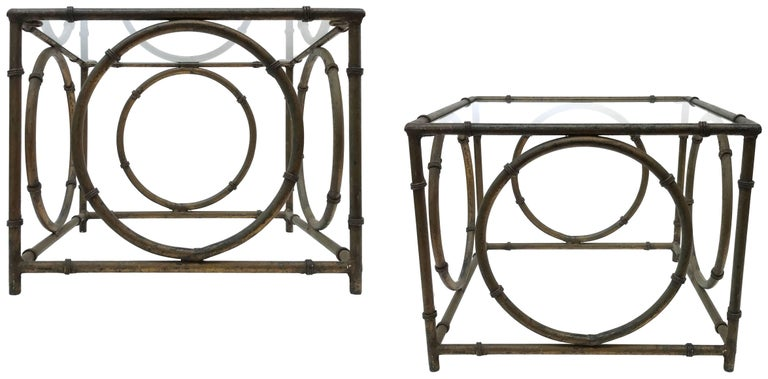 A wonderful pair of Italian wrought-iron and glass side tables. Elegant faux-bamboo with an applied, faux-bronze patina beautifully mottled from years of life outdoors. Great from all angles. Classic forms with a subtly surreal and op-art presence: