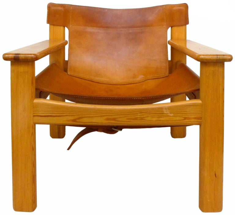 "A strikingly handsome pair of leather and pine ""Natura"" Chairs designed by Karin Mobring. Wonderful construction and patina to both the saddle leather and wood elements. A rugged and very chic seating statement, very reminiscent to the"