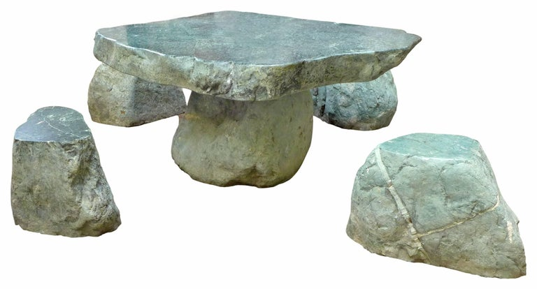 "An incredible, low, organic table and stools set in a lush, green granite. A fantastic grouping of wonderfully unexpected scale, form and material; a low, free-edge, thick-slab-top table surrounded by four, variously-sized, free-edge ""boulder"""