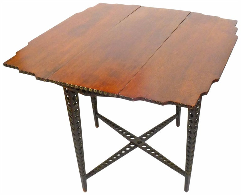 Early 20th Century Drop-Leaf Wood and Brass-Grommet Table In Good Condition For Sale In Los Angeles, CA