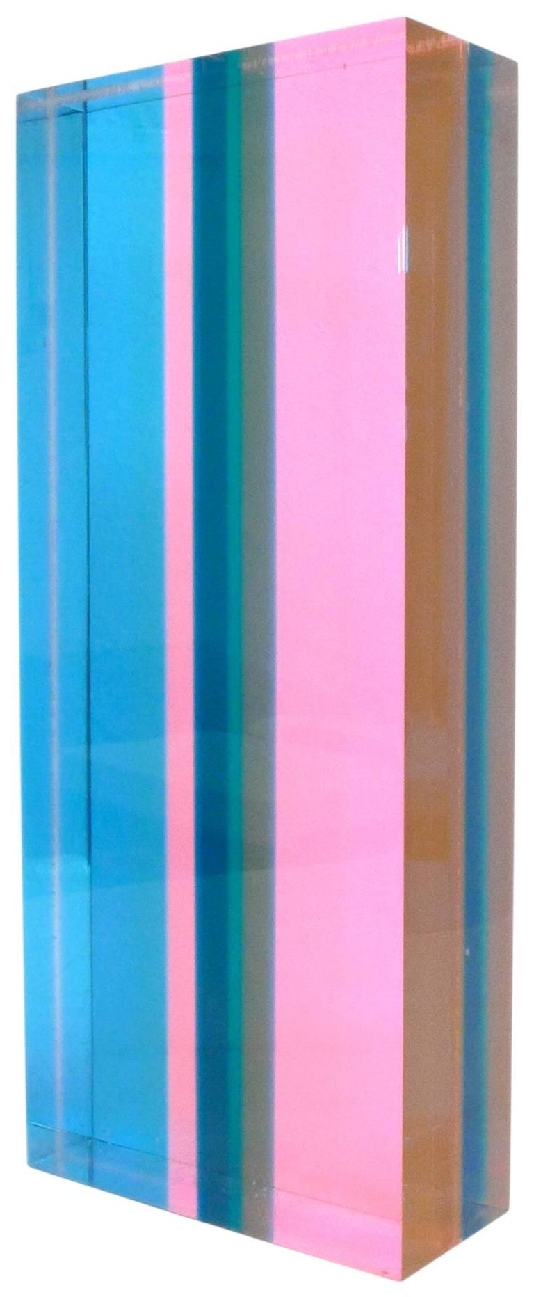 A fantastic, laminated-Lucite sculpture by Los-Angeles-based artist Vasa Mihich. A kaleidoscopic, mini-monolith; vibrant hues overlap and blend as one's vantage point changes. Enticing from all angles and even encourages one to hold and behold, an