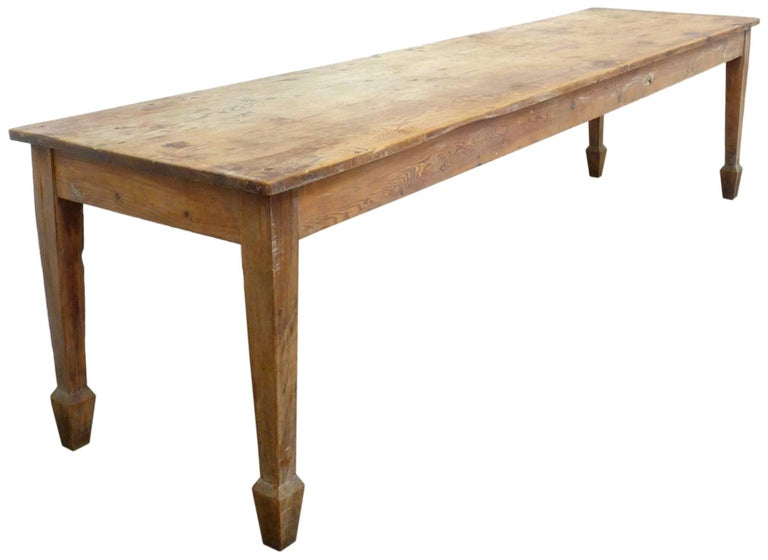 An extremely impressive and beautiful 19th century English farm table. Fantastic scale, form, patina and vibe; wonderful, carved and faceted leg details as well as dimensions that could easily accommodate ten dinner guests. An extremely elegant and