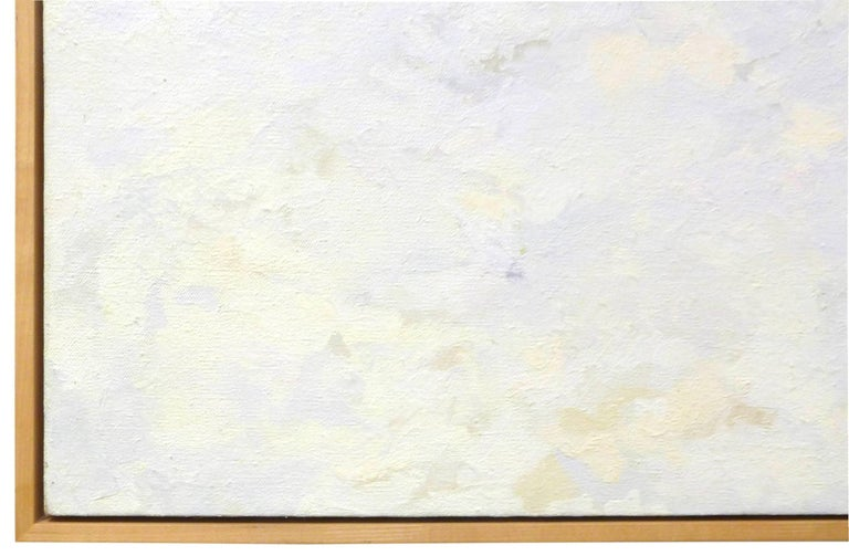 A beautifully Minimalist and understated oil on canvas painting. Subtle white, off-white. light blue and light grey tones create an abstract, almost sky-like composition. A very soothing yet visually alluring work. Beautifully framed in a simple,