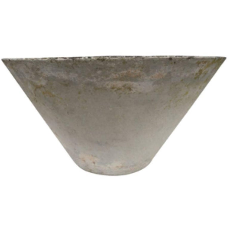 French conical planters, circa 1960 bring a vintage feeling with their worn age and patina as well as symmetry and balance that comes with the chic tapered look. We carry a variety of these modern French planters varying in dimensions and creator.