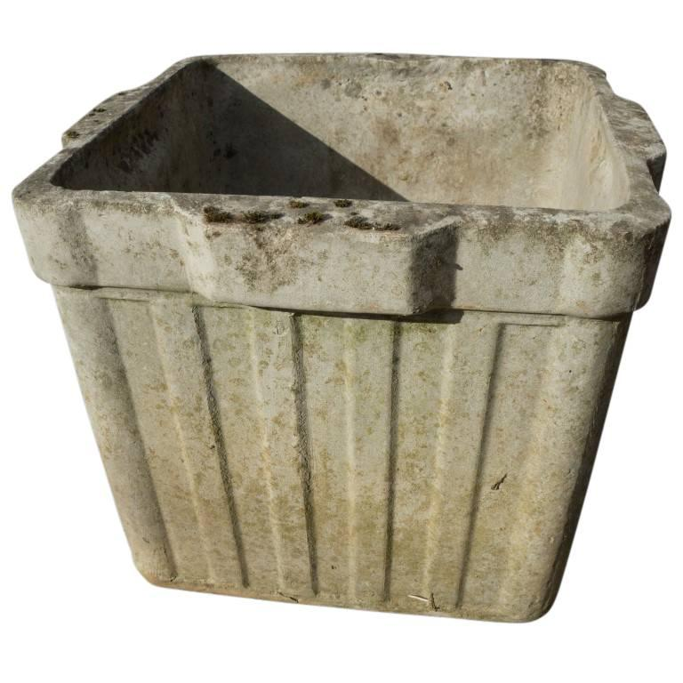 These charming box planters are available individually or in sets of up to 12. For use in landscape or interior garden design, these cement box planters have a ribbed outside, and protruding handles on the top lip. Minimal and lovely, born during