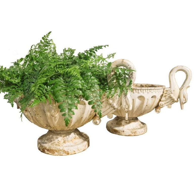 French antique urns for the home or garden, circa 1930, these French urns could easily be from the late 19th century based on the similarity to swan handle urns from that era. Made of cast iron and painted white with a large 14 inch rim bowl that is