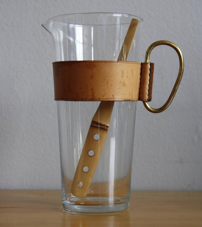 A Small Glass Pitcher With A Removable Handcrafted Leather Collar, Solid  Brass Handle And Bamboo