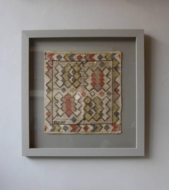 A vintage mid-20th century hand woven textile from Marta Maas-Fjetterström's workshop in Båstad, Sweden, designed by Barbro Nilsson.  The tapestry features geometric diamond and chevron shapes throughout. At first sight these appear to be arranged