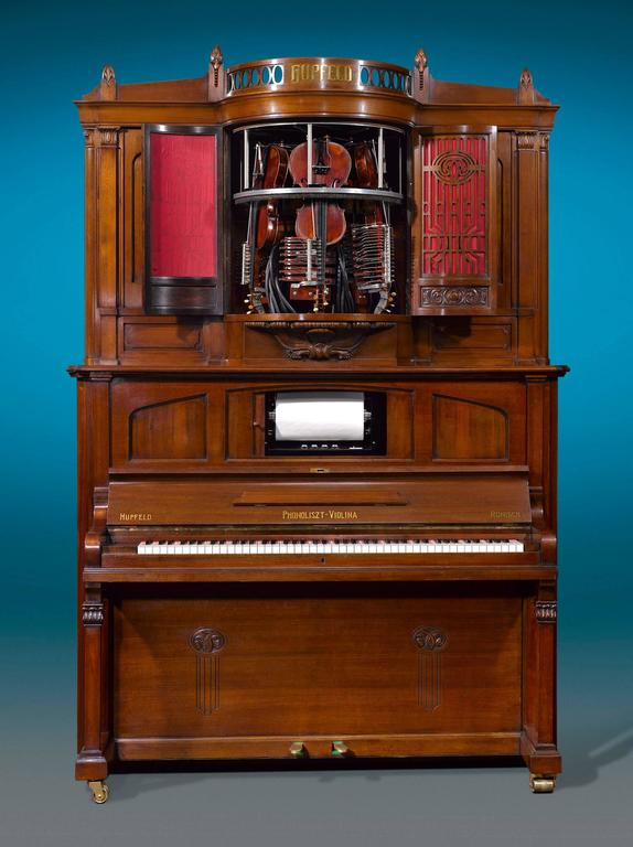 This incredible Hupfeld Phonoliszt-Violina Model B music cabinet is among the rarest and most advanced automatic music players of its time. The remarkable machine, crafted by renowned Leipzig firm of Ludwig Hupfeld, is one of the most mechanically