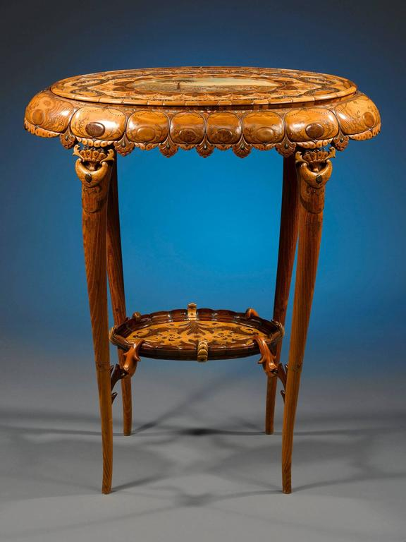 This incredible Art Nouveau work table is a one-of-a-kind tour de force of French cabinetmaking. The entire piece is handcrafted of a multitude of fine-grain fruitwoods carved, layered and inlaid into an elaborate and exquisite organic motif. A