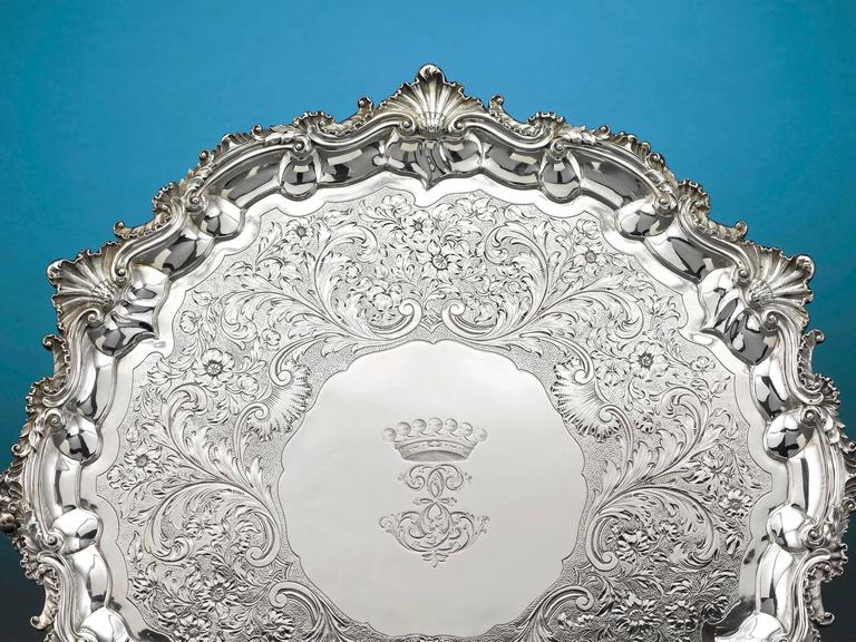 The classical elegance of this stunning Regency period silver tray is the signature of renowned silversmith Paul Storr. Adorned with a striking engraved border with a shell motif, this large William IV silver serving tray is also adorned with an