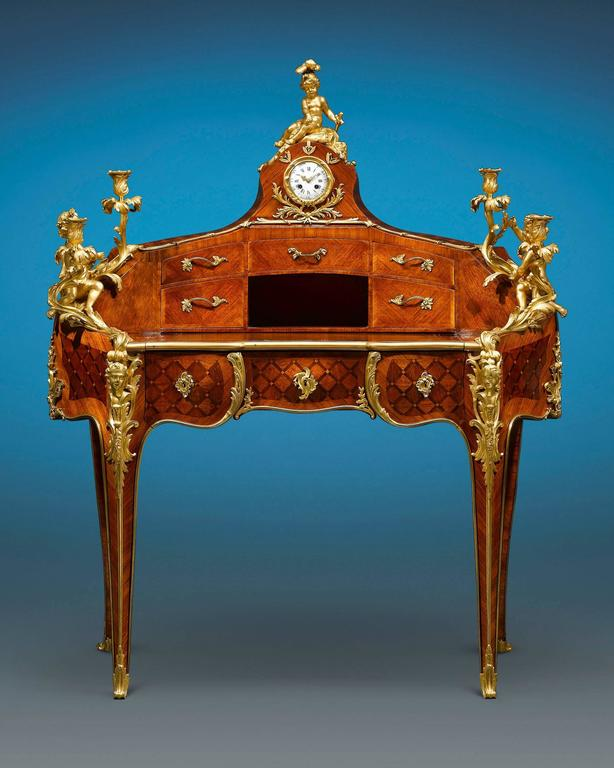 This fabulous and rare bureau à gradin, or tiered desk, was crafted by the highly respected ébéniste Theodore Millet of Paris, founder of the acclaimed Maison Millet firm. Displaying an outstanding rognon, or kidney shape, the desk is decorated