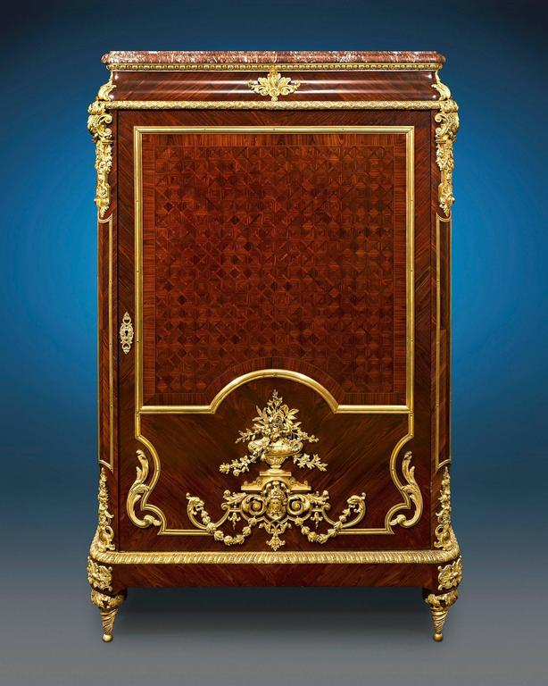 Enveloped in sumptuous parquetry and doré bronze, this majestic Louis XIV inspired French linen press displays the characteristics of superior craftsmanship and luxurious design seen in the creations of the iconic Françios Linke. Crafted of