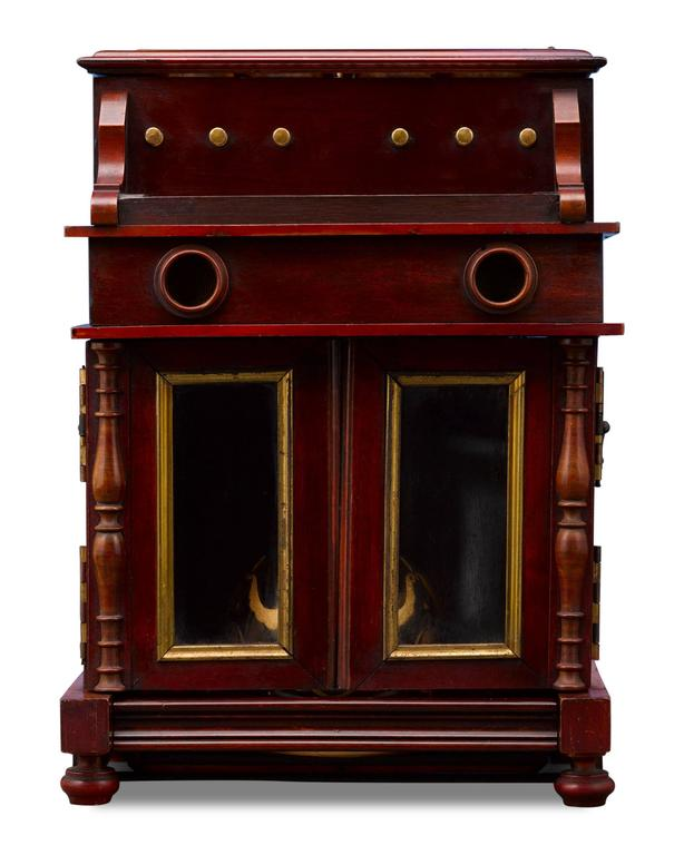 This rare and outstanding piano cave à liqueur provides both musical and liquid refreshment. Simply press the keyboard and one of two delightful airs from the hidden music box begins to play, causing the piano's glass panelled lid and doors to swing