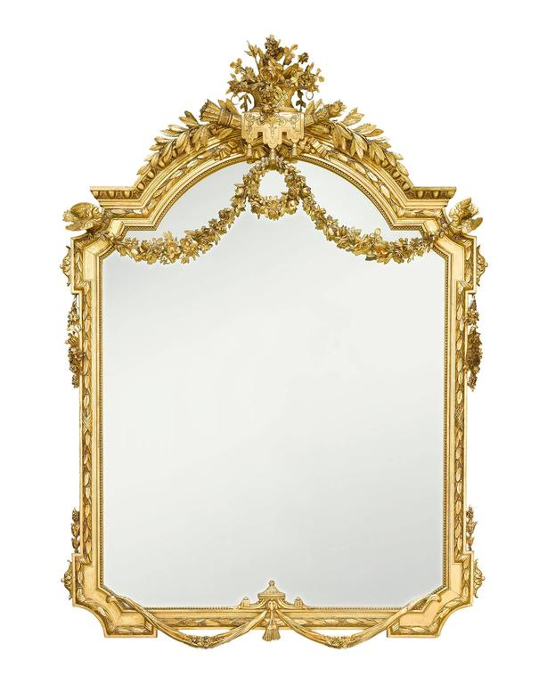 Grand in size and decoration, this exceptional Napoleon III-period mirror is further set apart by an elaborate giltwood frame that features decorative elements such as garlands, doves, a basket of flowers and Apollo's torch. The magnificent size,
