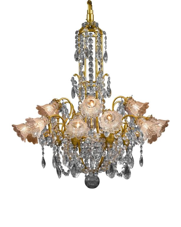 This Baccarat crystal and doré bronze chandelier of monumental size and opulent design is truly a splendid sight to behold. Hundreds of beautifully designed oversized, luminous prisms and beads of Baccarat crystal hang from scrolling branches of