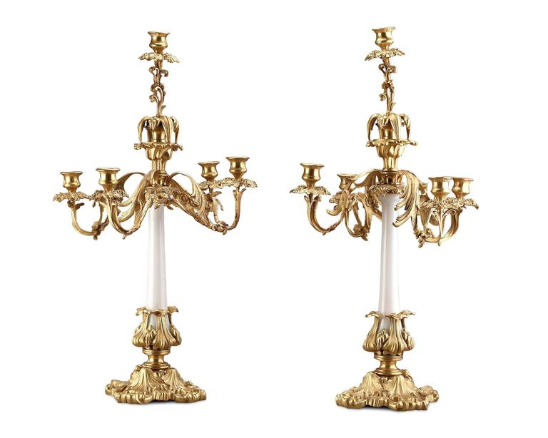 A lovely pair of French opaline glass candelabra beautifully mounted in gilded bronze.