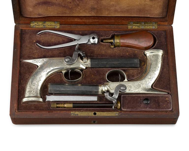 This handsome pair of English .54 caliber percussion belt pistols features elegant saw-handle grips that greatly improve shooting accuracy and stability. The octagonal, smooth bore barrel is crafted of strong Damascus steel, terminating in Fine