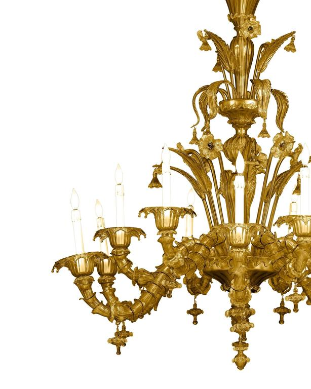 This majestic Murano glass chandelier is one of the finest examples of the exceptional Venetian glassmaking tradition. Composed of twelve lights sumptuously decorated with a garden of delicate flowers, flourishing leaves and a multitude of sculpted
