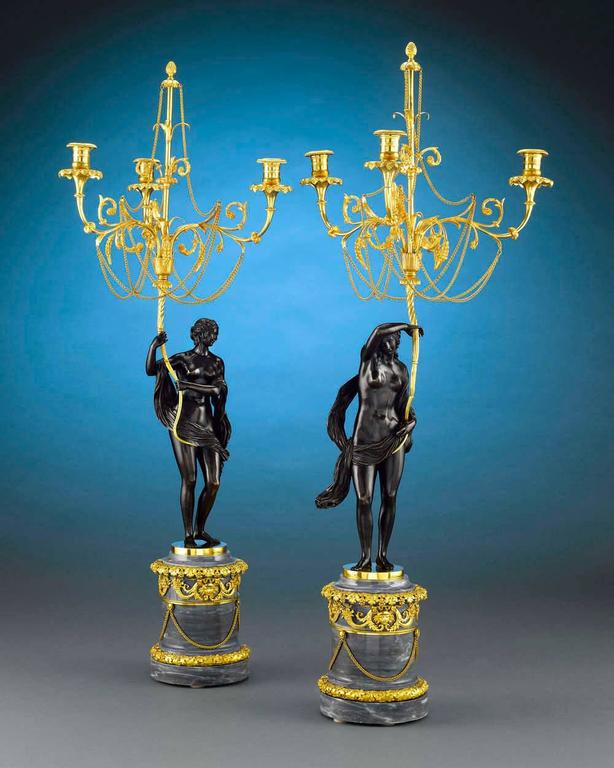 The epitome of Russian craftsmanship, this majestic and incredibly rare pair of candelabra would have been fit for the Czar. These superb Louis XVI style figural bronze candelabra were created in the Neoclassical taste that permeated Russia during