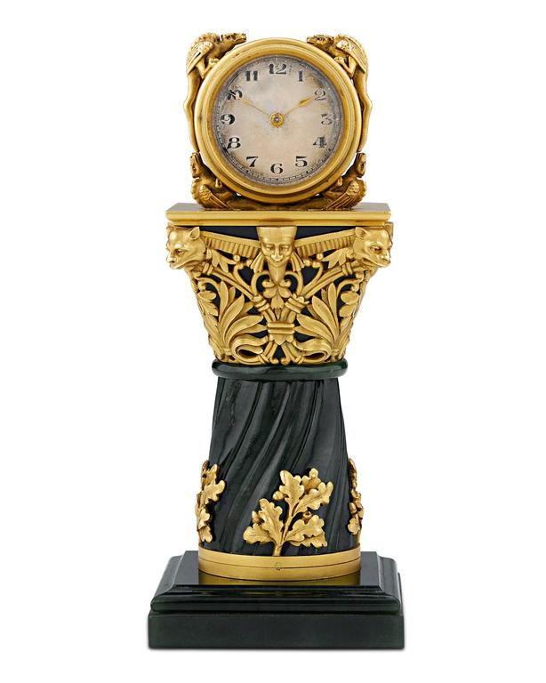 An exceptionally rare objet d'art, this opulent and incredibly rare French miniature clock is crafted of solid 18-karat gold and jade. Crafted by Parisian jeweler Paul Frey and retailed by Gompers, this handcrafted masterpiece is exemplary of the