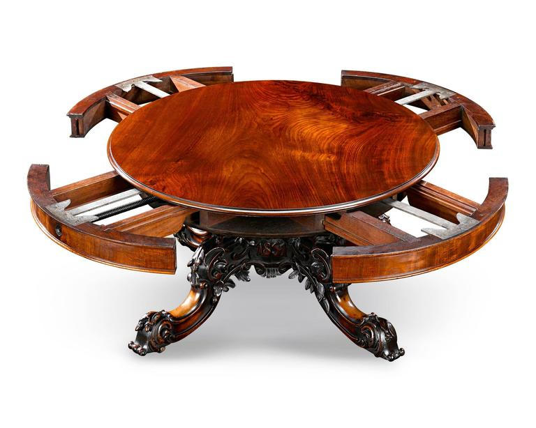 A masterpiece of both cabinetmaking and mechanical engineering, this one-of-a-kind expanding table was crafted by the renowned cabinetmaker Samuel Hawkins of London for the Great Exhibition of 1851. Diminutive in size, the fascinating table was