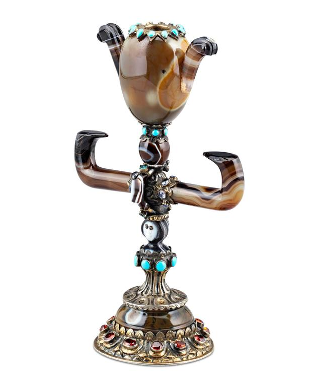 Masterfully handcrafted with clear influences of Chinese culture, this rare and unique agate and jeweled vase demonstrates Viennese command of the decorative arts.  Crafted of carved and polished agate in a wonderful display of artistry, this