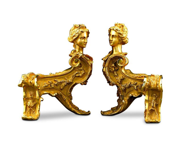This rare and ornate pair of bronze ormolu chenets, or andirons, takes the form of two majestic sphinxes. Crafted in a thrilling Louis XIV style, these bronze ormolu fireplace guards also exhibit Classic Rococo decoration, such as flowering