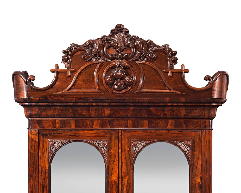 One of the rarest furniture forms created by John Henry Belter, this armoire is a testament to this legendary cabinet maker's talent. Recognized as a Pioneer in design and craftsmanship, Belter is widely considered the finest furniture maker of the